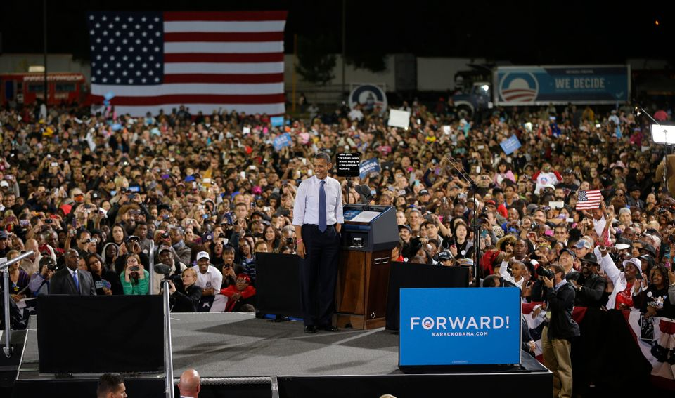 President Barack Obama looks at the crowd from the stage during a campaign event at Doolittle Park, Wednesday, Oct. 24, 2012,