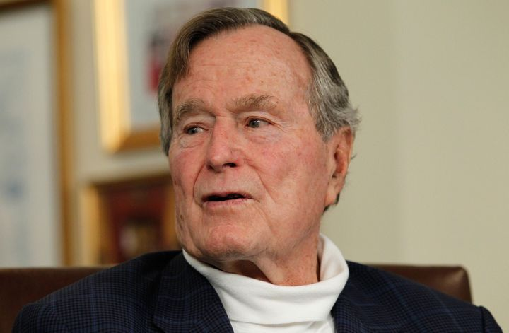 HOUSTON, TX - MARCH 29:   Former President George H.W. Bush talks with Republican presidential candidate, former Massachusett