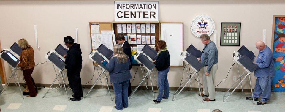 People cast their ballots at electronic voting booths at a Madison, Miss., precinct, Tuesday, Nov. 6, 2012. Local officials e