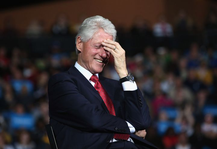 YOUNGSTOWN, OH - OCTOBER 29:  Former U.S. President Bill Clinton laughs as U.S. Vice President Joe Biden speaks during a camp