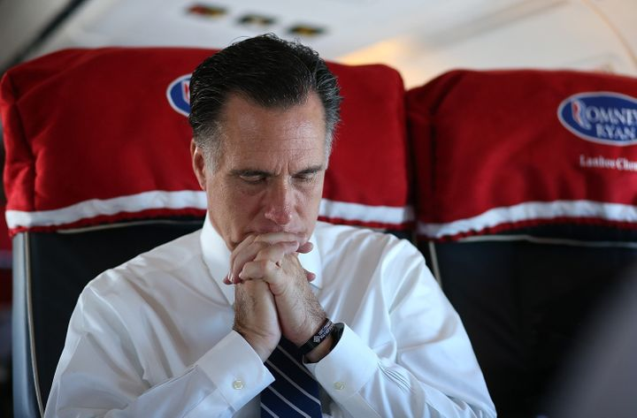 IN FLIGHT, OH - NOVEMBER 02:  Republican presidential candidate, former Massachusetts Gov. Mitt Romney sits aboard his campai