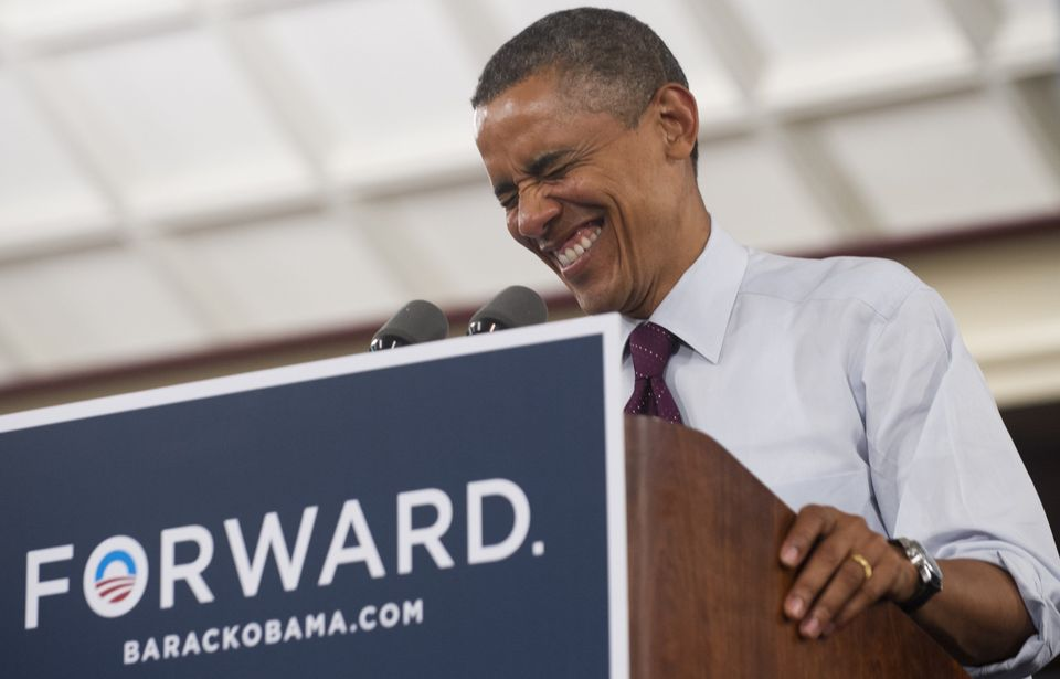 US President Barack Obama laughs while speaking during a campaign event at the Cincinnati Music Hall in Cincinnati, Ohio , Ju