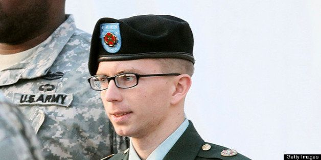 FORT MEADE, MD - FEBRUARY 23: Army Private Bradley Manning is escorted away from his Article 32 hearing February 23, 2012 in Fort Meade, Maryland. During the hearing, Manning deferred his plea to the 22 charges against him and deferred a decision over whether he wanted a military judge or a jury to hear his case. (Photo by Mark Wilson/Getty Images)