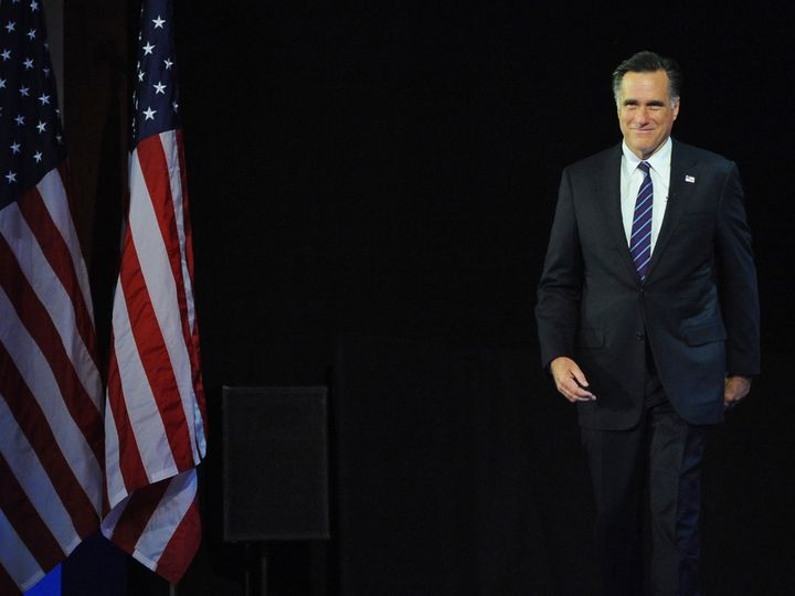 Republican presidential candidate Mitt Romney arrives on stage on election night November 7, 2012 in Boston, Massachusetts, m
