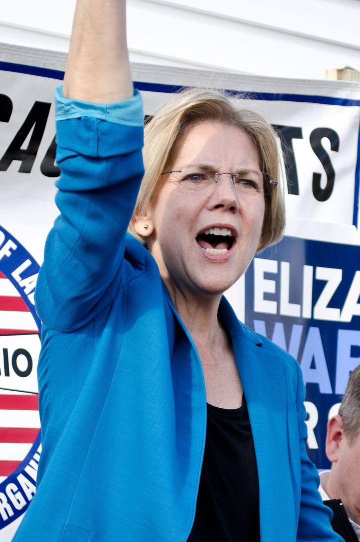 description 1 en:Elizabeth Warren | Elizabeth Warren  at a campaign rally in en:Auburn, Massachusetts | Auburn, Massachusetts