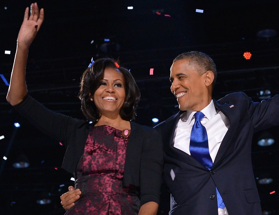 U.S. President Barack Obama celebrates on stage with his wife Michelle after delivering his victory speech in Chicago on Nove