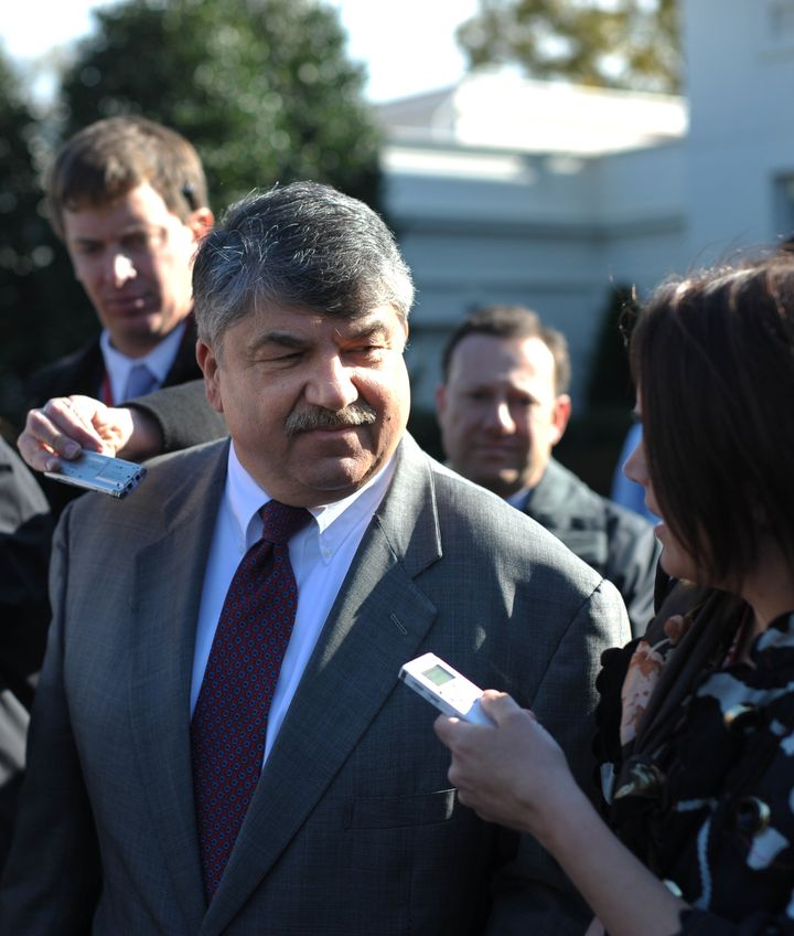 American Federation of Labor and Congress of Industrial Organizations (AFL–CIO) President Richard Trumka (L) speaks to report