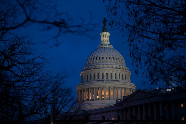 WASHINGTON, DC - DECEMBER 31: The U.S. Capitol illuminates at dusk on Capitol Hill on December 31, 2012 in Washington, DC. Th