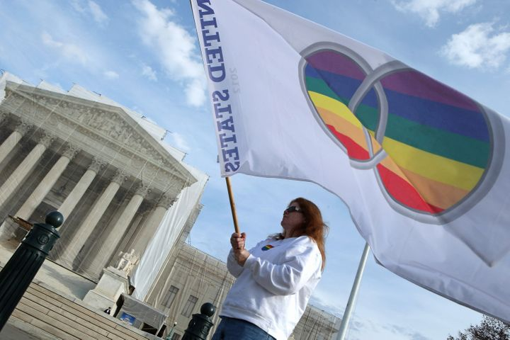WASHINGTON, DC - NOVEMBER 30:  Same-sex marriage proponent Kat McGuckin of Oaklyn, New Jersey, holds a gay marriage pride fla