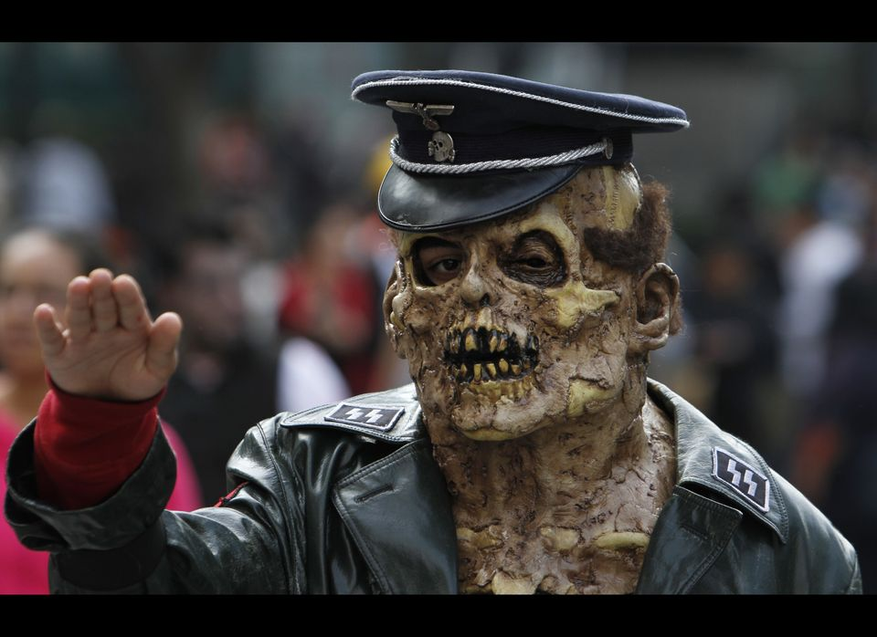 A man dressed as a zombie gestures during the V edition of the so-called 'Zombie Walk' in Mexico City, Saturday, Nov. 26, 201