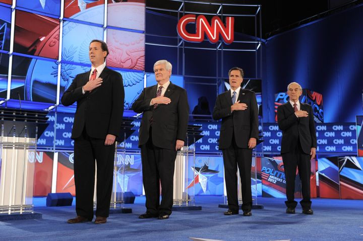 Republican presidential candidates listen to the American national anthem prior to the start of  the Florida Republican Presi