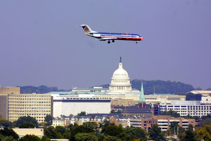 395437 05: With the U.S. Capitol in the background an American airlines shuttle comes in to land at Washington's Reagan Natio