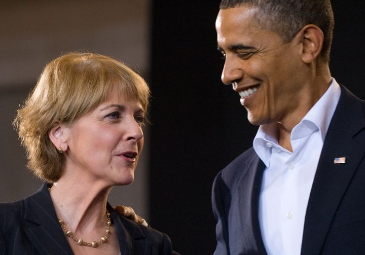 US President Barack Obama talks with US Senate candidate Democrat Martha Coakley during a campaign rally for Coakley at the C