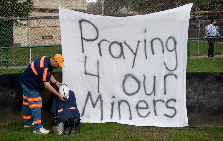 Terry Bailey of Naoma, West Virginia and a coal miner at Progress Coal, sets up a memorial for the 25 miners that were killed