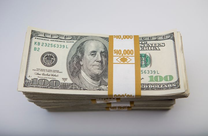 Stacks of U.S. $100 bills are arranged for a photograph in New York, U.S., on Thursday, Feb. 7, 2013. The U.S. dollar advance