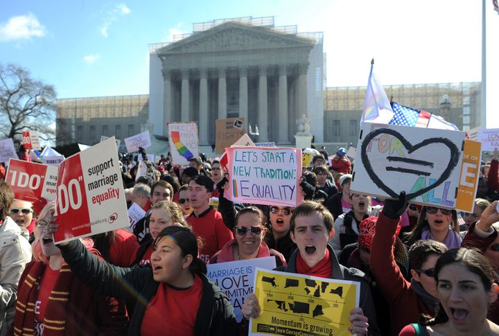 Same-sex marriage supporters shout slogans in front of the US Supreme Court on March 26, 2013 in Washington, DC. The US Supre