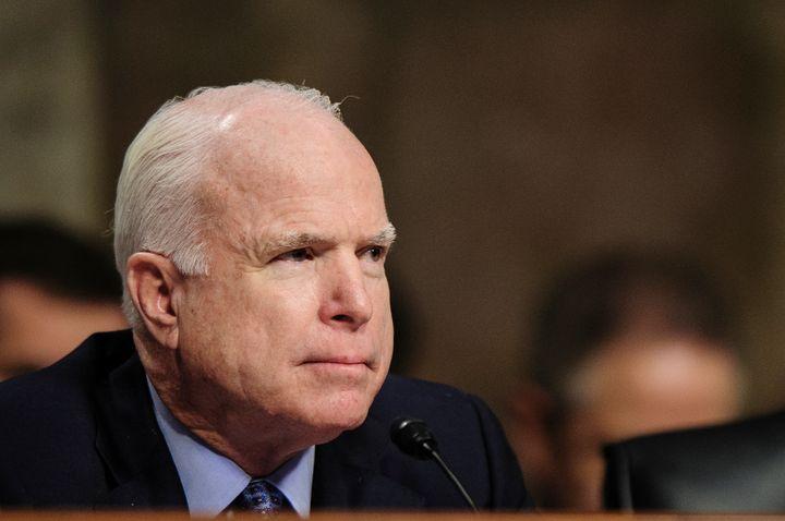 Senator John McCain (R-AZ) listens as former Senator Chuck Hagel (R-NE) testifies before the Senate Armed Services Committee,