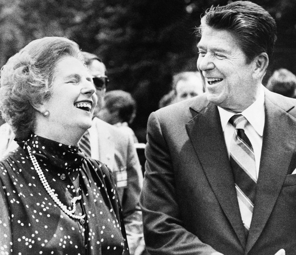 FILE - U.S. President Ronald Reagan, right, and Britain's Prime Minister Margaret Thatcher, share a laugh during a break from