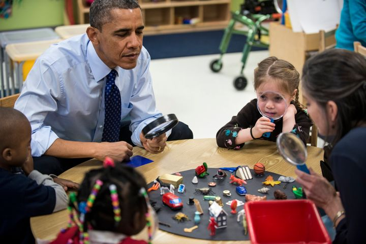 US President Barack Obama plays a learning game while visiting children at College Heights Early Childhood Learning Center Fe