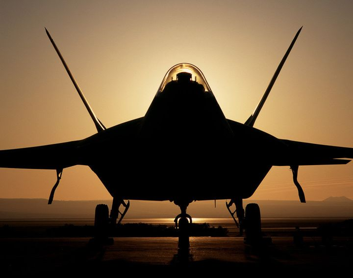 393295 05: (FILE PHOTO) An F-22 Raptor 4001 stealth fighter is silhouetted against the setting sun in this undated file photo