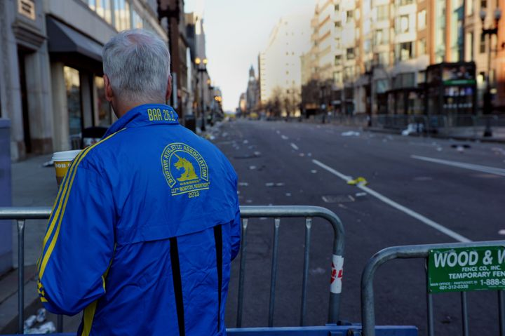 A man who ran in the Boston Marathon looks down a closed-off Boylston Street April 16, 2013 in Boston, Massachusetts, in the