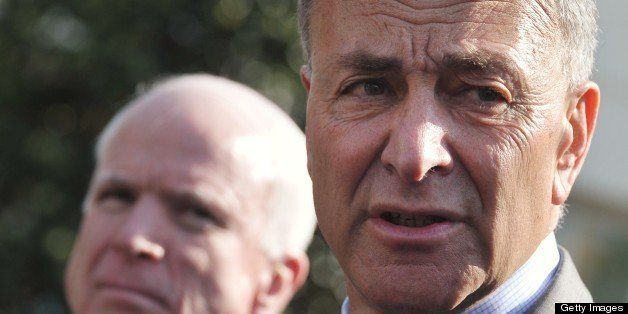 Senator Chuck Schumer, D-NY, speaks to reporters as Senator John McCain (L), R-AZ, looks on after a meeting with US President