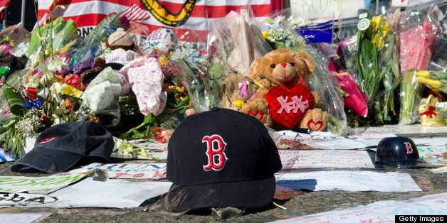 A Boston Red Sox cap left at a makeshift memorial on the Boston Marathon route April 18, 2013 in Boston. No arrests have been