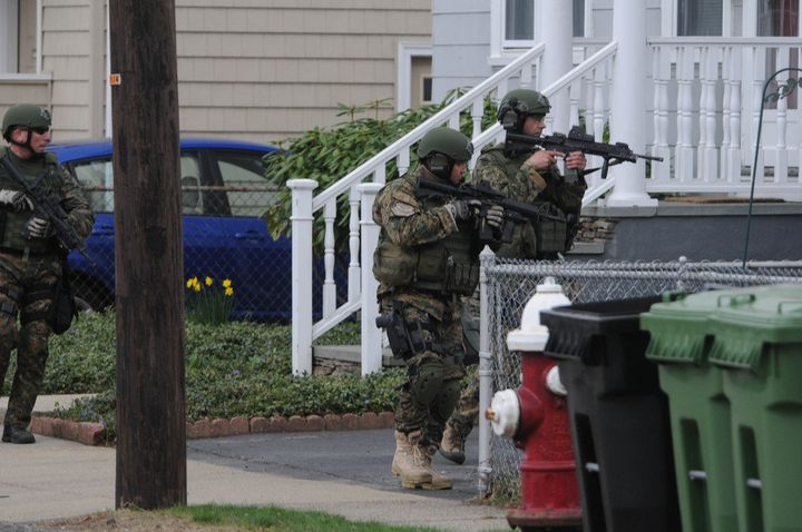 WATERTOWN - APRIL 19:  Police conduct a door-to-door search for 19-year-old Boston Marathon bombing suspect Dzhokhar A. Tsarn