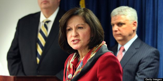 BOSTON - JANUARY 17: US Attorney Carmen Ortiz and members of the FBI and other law enforcement agencies including Boston Poli