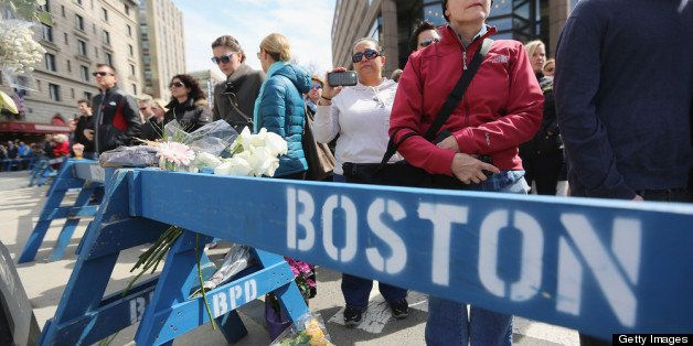 BOSTON, MA - APRIL 22:  People gather during a moment of silence honoring the Boston Marathon bombing victims in Copley Squar