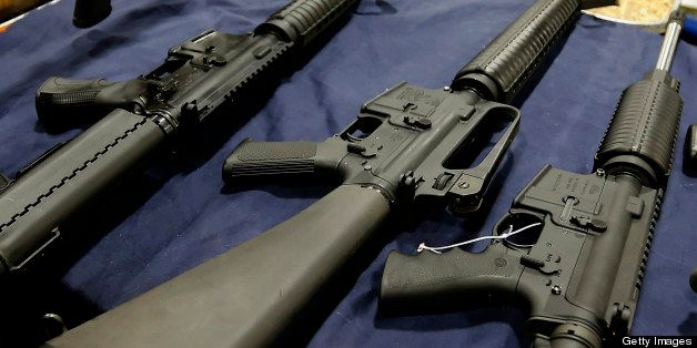 A semi-automatic assault rifle made by Bushmaster Firearms International LLC, , center, is displayed with other guns for sale