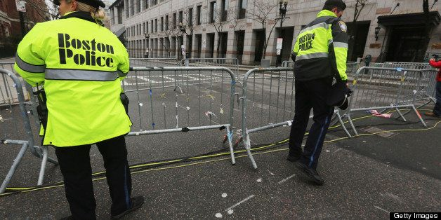 BOSTON, MA - APRIL 23:  Police close a barricade along a still closed section of Boylston Street near the site of the Boston
