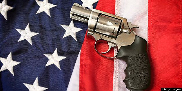 A handgun resting on an American flag, representing the Second Amendment of the US Constitution, the right of patriotic Ameri