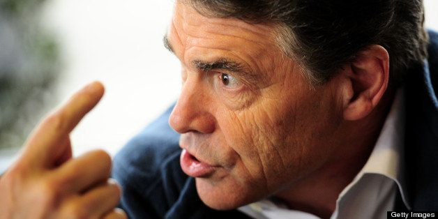 Republican presidential hopeful Rick Perry gestures as he has lunch with supporters at the Drive-In Restaurant in Florence, S