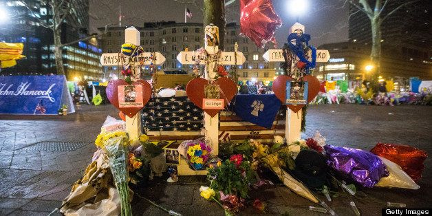 BOSTON - APRIL 24: The makeshift memorial in Copley Square photographed after Boylston Street was reopened to the public at a