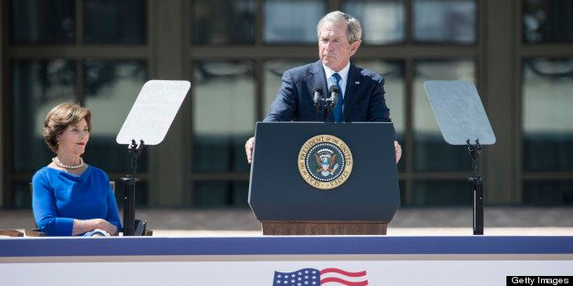 Former First Lady Laura Bush listens while former US President George W. Bush speaks during a dedication ceremony at the Geor