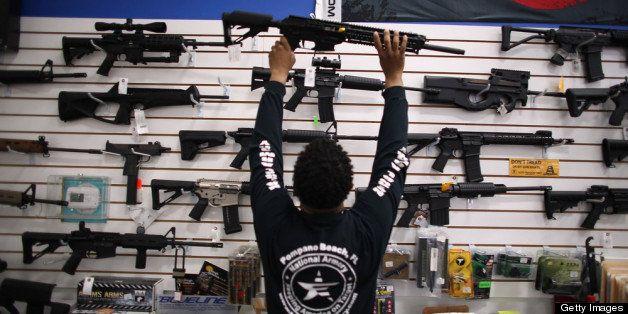 POMPANO BEACH, FL - APRIL 11:  As the U.S. Senate takes up gun legislation in Washington, DC , Mike Acevedo puts a weapon on