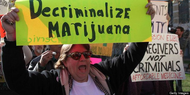 OAKLAND, CA - JANUARY 04:  A medical marijuana activist holds a sign during a rally January 4, 2010 in Oakland, California. D