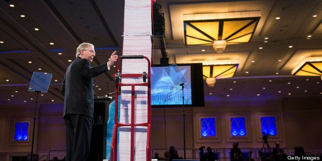 UNITED STATES - MARCH 15: Senate Minority Leader Mitch McConnell, R-Ky., speaks next to a tower of 20,000 pages of health car