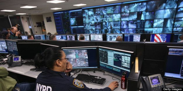 NEW YORK, NY - APRIL 23:  Police and private security personel monitor security cameras at the Lower Manhattan Security Initi