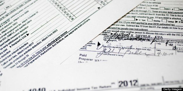 Copies of the U.S. Department of the Treasury Internal Revenue Service (IRS) 1040 Individual Income Tax form for the 2012 tax year belonging to U.S. Vice President Joseph Biden and his wife, Jill Biden, is arranged for a photograph in Washington, D.C., U.S., on Friday, April 12, 2013. In 2012, Vice President Joseph Biden and his wife, Jill, had $385,072 in adjusted gross income and paid $87,851 in federal taxes for a 22.8 percent rate, tax returns released today showed. Photographer: Andrew Harrer/Bloomberg via Getty Images