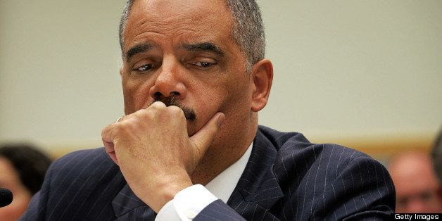 WASHINGTON, DC - MAY 15: Attorney General Eric Holder faces the House Judiciary committee about journalists phone records and IRS improprieties, on May, 15, 2013 in Washington, DC. (Photo by Bill O'Leary/The Washington Post via Getty Images)