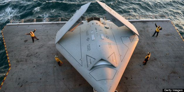 ATLANTIC OCEAN - MAY 14:  In this handout released by the U.S. Navy, Sailors move an X-47B Unmanned Combat Air System (UCAS)