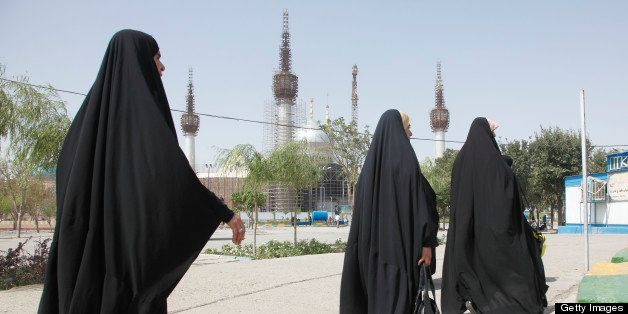 TEHRAN, IRAN - AUGUST 14: Iranian women in chadors walk at the Holy Shrine mausoleum of Ayatollah Khomeini on August 14, 2012