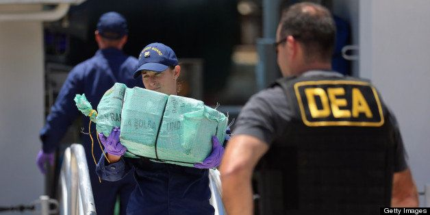 MIAMI, FL - APRIL 26:  Crewmembers from the Coast Guard Cutter Bernard C. Webber offload some of the 2,200 pounds of cocaine,