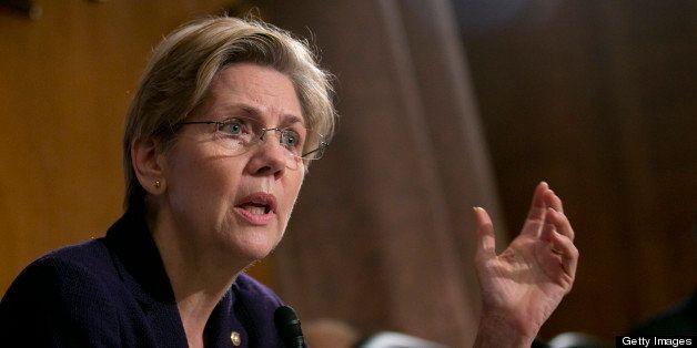 Senator Elizabeth Warren, a Democrat from Massachusetts, questions witnesses during a Senate Banking Committee hearing in Was