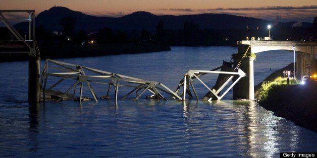 MT. VERNON, WASHINGTON  - MAY 23: Crews survey the scene of a bridge collapse on Interstate 5 on May 23, 2013 near Mt. Vernon