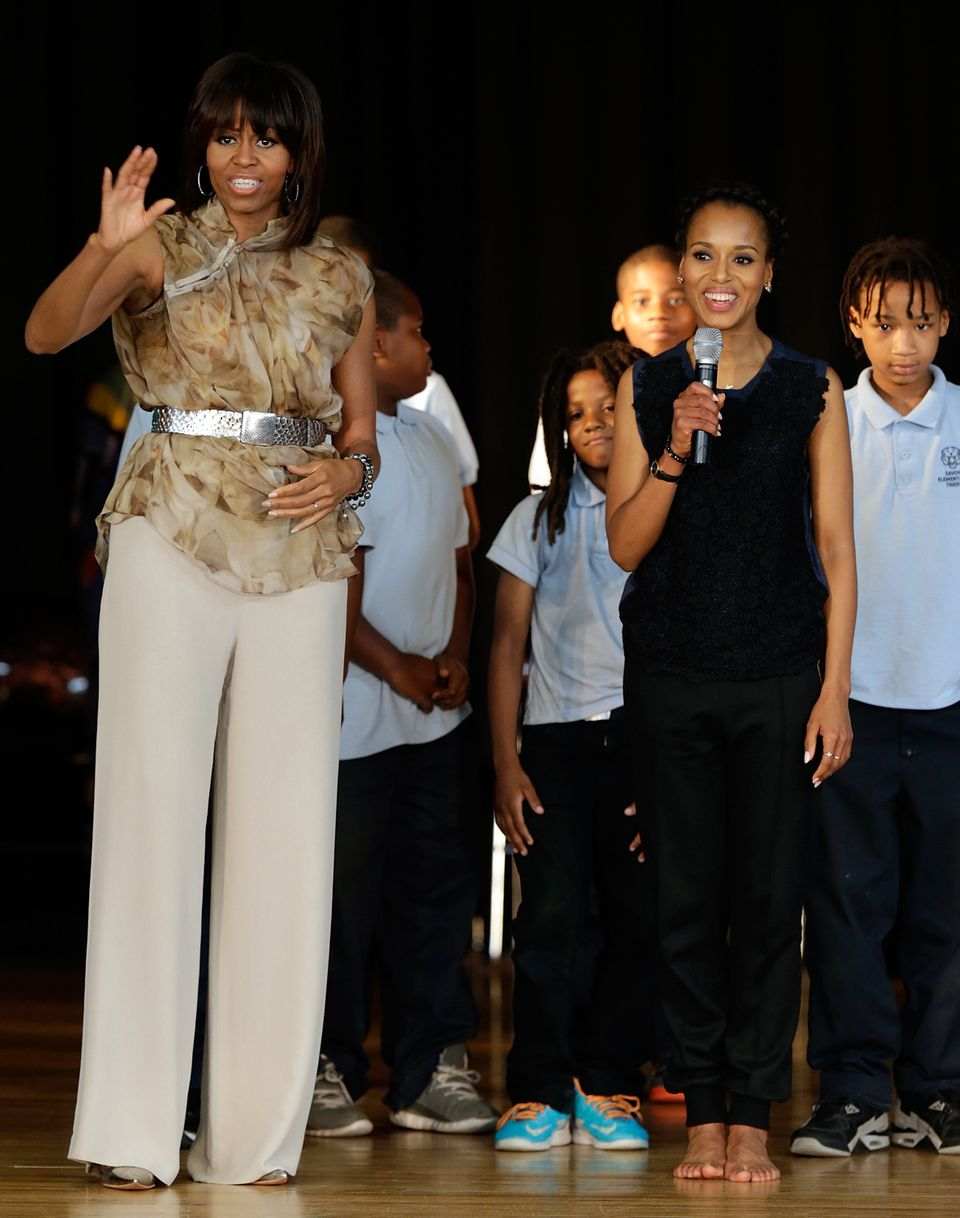 U.S. first lady Michelle Obama and actress Kerry Washington speak to students during an event while visiting the Savoy School