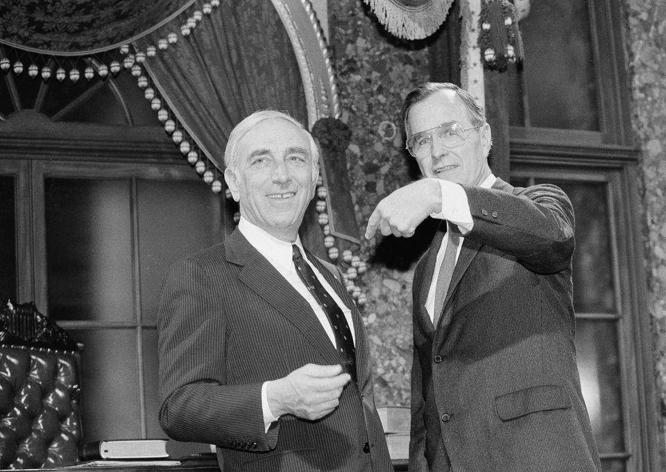 Then-Vice President George Bush (right) points to Sen. Frank Lautenberg (D-N.J.) (left), after Bush administered the oath of