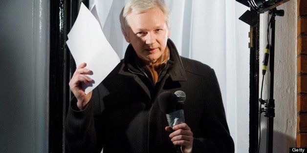 Wikileaks founder Julian Assange addresses members of the media and supporters from the window of the Ecuadorian embassy in K